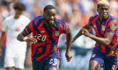 KANSAS CITY, KS - JULY 18: Shaq Moore #20 of the United States scores and celebrates his goal during a game between Canada and USMNT at Children