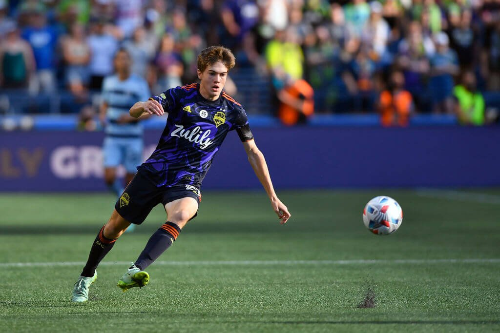 SEATTLE, WASHINGTON - JULY 25: Reed Baker-Whiting #21 of Seattle Sounders chases down the ball during the game against the Sporting Kansas City at Lumen Field on July 25, 2021 in Seattle, Washington. The Sporting Kansas City won 3-1. (Photo by Alika Jenner/Getty Images)