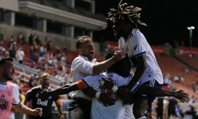 Jun 23, 2021; Sandy, Utah, CAN; Vancouver Whitecaps midfielder Janio Bikel (19) celebrates his second half stoppage time goal with teammates and head coach Marc Dos Santos against the Los Angeles Galaxy at Rio Tinto Stadium. Mandatory Credit: Rob Gray-USA TODAY Sports