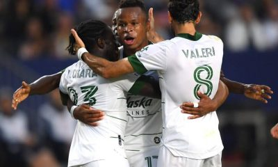 Jul 30, 2021; Carson, California, USA;  Portland Timbers forward Yimmi Chara (23) is congratulated by  forward Jeremy Ebobisse (17) and midfielder Diego Valeri (8) after scoring a goal in the first half of the game against the Los Angeles Galaxy at StubHub Center. Mandatory Credit: Jayne Kamin-Oncea-USA TODAY Sports