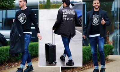 Las estrellas del Manchester City vuelan para el choque de la Liga de Campeones con atuendos 'horrendos' compuestos de jeans enrollados y blazers
